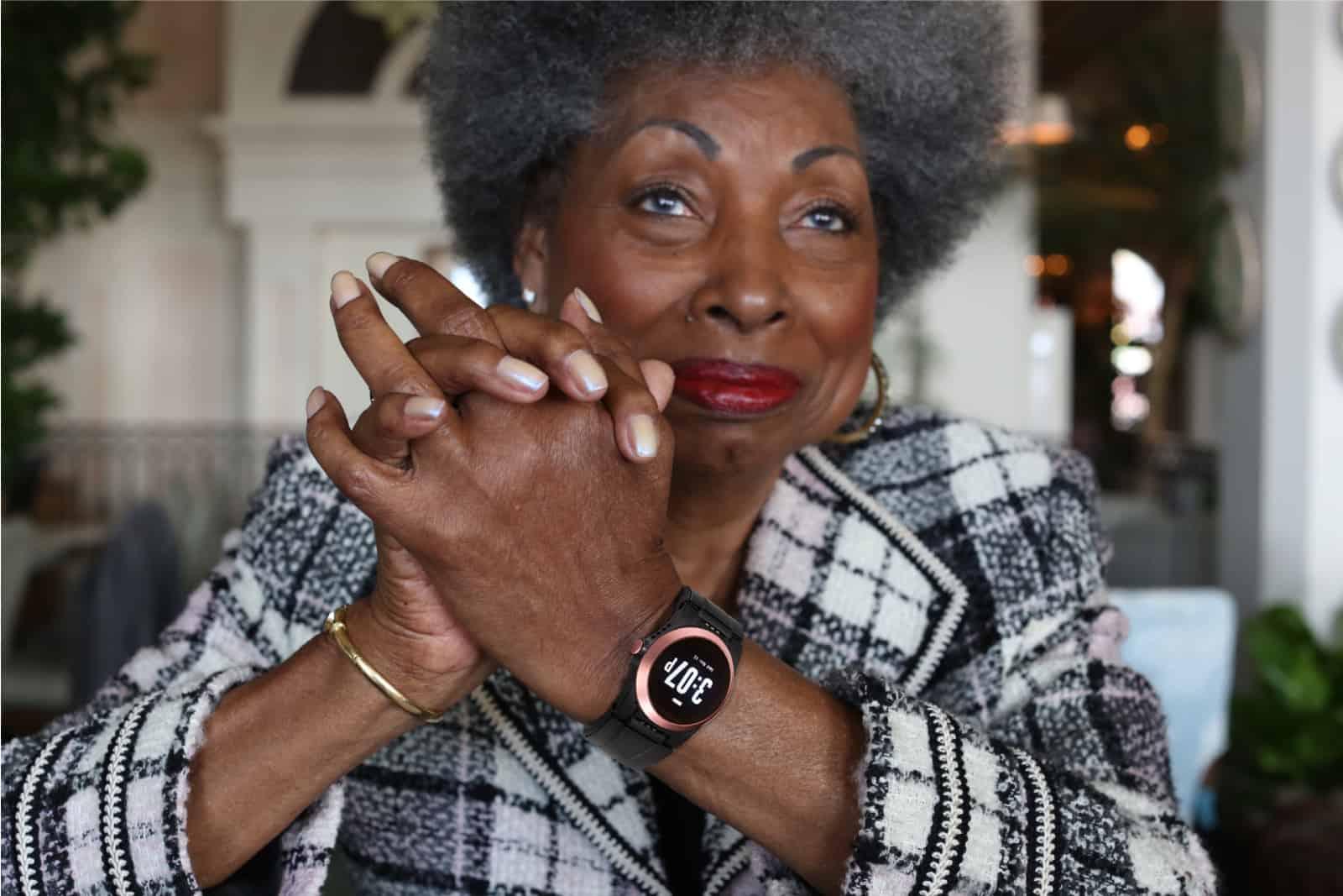 Lady sitting, wearing a Kanega Watch